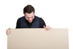 Man looking down on blank poster Royalty Free Stock Photos