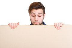 Man looking down on blank poster sign Royalty Free Stock Image