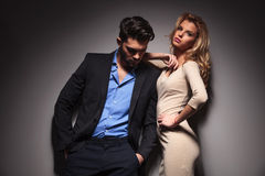 Man looking down while his girlfriend is leaning on him Royalty Free Stock Image