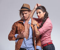 Man looking down while his girlfriend is leaning on him Royalty Free Stock Photography