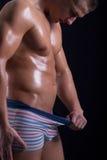 Man looking down in his pants. Muscular  man looking down in his pants Stock Photography
