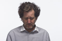 Man looking down and miserable, horizontal Stock Images