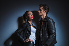 Man looking down on sexy woman in leather jacket Royalty Free Stock Image