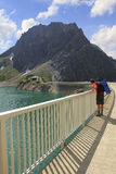 Man looking down to artificial lake lunersee Royalty Free Stock Image