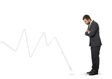 Man looking at downturn graph Royalty Free Stock Images