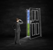 Man looking at drawing door Royalty Free Stock Images
