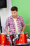 Man Looking At Drums In Recording Studio Royalty Free Stock Photo