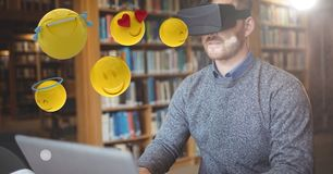 Man looking at emojis on VR glasses Royalty Free Stock Photos