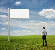 Man looking at empty billboard Stock Photos