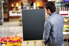 The man looking at an empty board Stock Photo