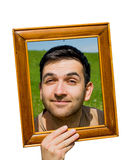 Man looking through an empty frame. Stock Photo