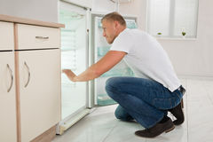 Man Looking Into An Empty Refrigerator Stock Image