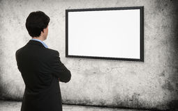 Man looking on the empty screen Stock Image