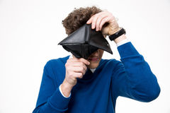 Man looking through empty wallet at the camera Royalty Free Stock Photos