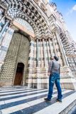 Man looking at the entrance of San Lorenzo cathedral in Genoa, Italy Stock Photo