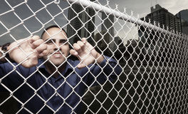 Man looking through the fence Royalty Free Stock Photography