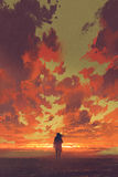 Man looking at fiery sunset sky. Lonely man looking at fiery sunset sky with digital art style, illustration painting Royalty Free Stock Photos