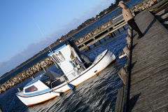Man looking at fishing boat Royalty Free Stock Photography