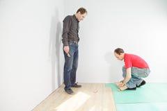 Man looking at  flooring installation Stock Image