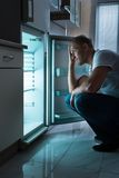 Man Looking For Food In Fridge Royalty Free Stock Images