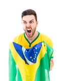 Man looking forward holding the Brazilian flag Royalty Free Stock Images