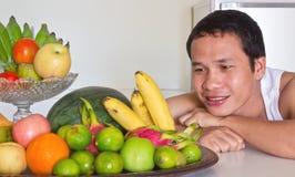 Man looking at fruits Stock Photography