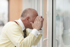 Man looking through the glass Royalty Free Stock Photos