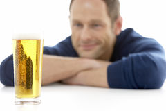 Man Looking At Glass Of Beer Royalty Free Stock Image