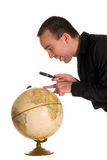 Man Looking At Globe Royalty Free Stock Image