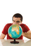 Man looking at globe Stock Images