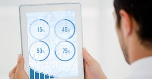 Man looking at graph chart on digital tablet Stock Photography