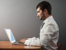 Man looking at graph Royalty Free Stock Image