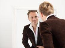 Man looking at himself in mirror Stock Photos