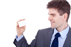 Man looking at his  business card Royalty Free Stock Image