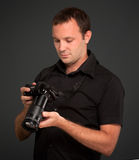 Man looking at his camera Royalty Free Stock Image