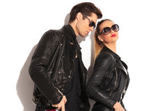 Man looking at his girlfriend, wearing leather jackets. Studio picture on white background Stock Photos