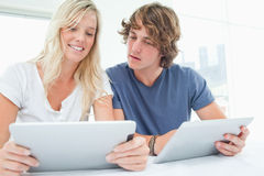 A man looking into his girlfriends tablet Stock Photography