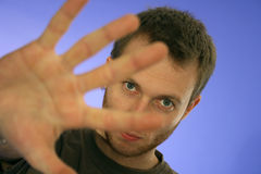 Man looking through his hand Stock Image