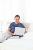 Man looking at his laptop Stock Photos