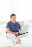 Man looking at his laptop Stock Photo