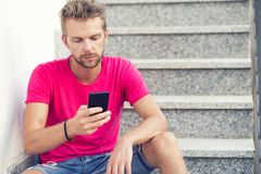 Man looking at his mobile phone royalty free stock images