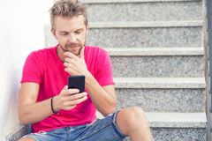 Man looking at his mobile phone royalty free stock photo