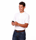 Man is looking at his mobile to text a message. Stock Photography
