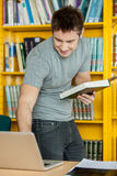 Man looking his notebook Royalty Free Stock Image