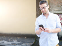 Man looking his smartphone Stock Photos