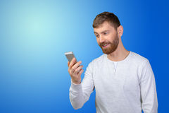 man looking at his smartphone Royalty Free Stock Photography
