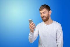 Man looking at his smartphone Royalty Free Stock Photos