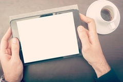 Man looking his tablet device Royalty Free Stock Photography