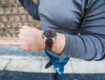Man looking at his watch - detailed view Royalty Free Stock Photo