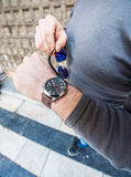 Man looking at his watch - pointing with sunglasses Stock Photography
